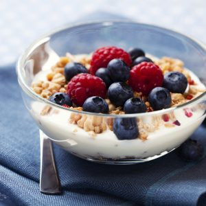 A bowl of oatmeal with yogurt and fruits is perfect for breakfast